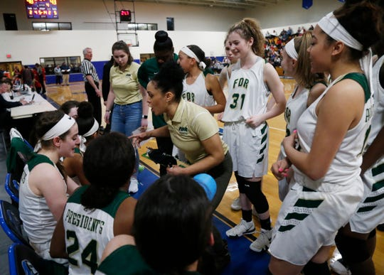 Roosevelt coach Jessica Paden discusses strategy with her girls basketball team in a timeout during the Class A regional semifinal against Tappan Zee on March 6.