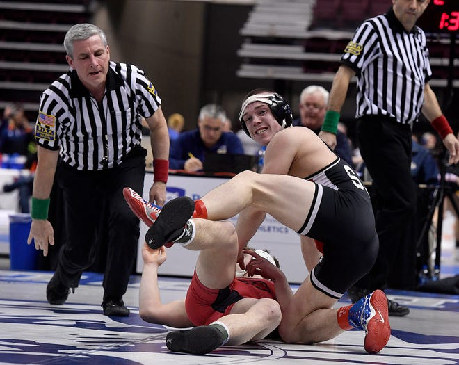 Colby Romjue of Susquehannock looks back to his coaches after pinning Brett Breidor of Boyertown in the 152-pound preliminary round of the PIAA Class 3-A wrestling championships on Thursday. John A. Pavoncello photo