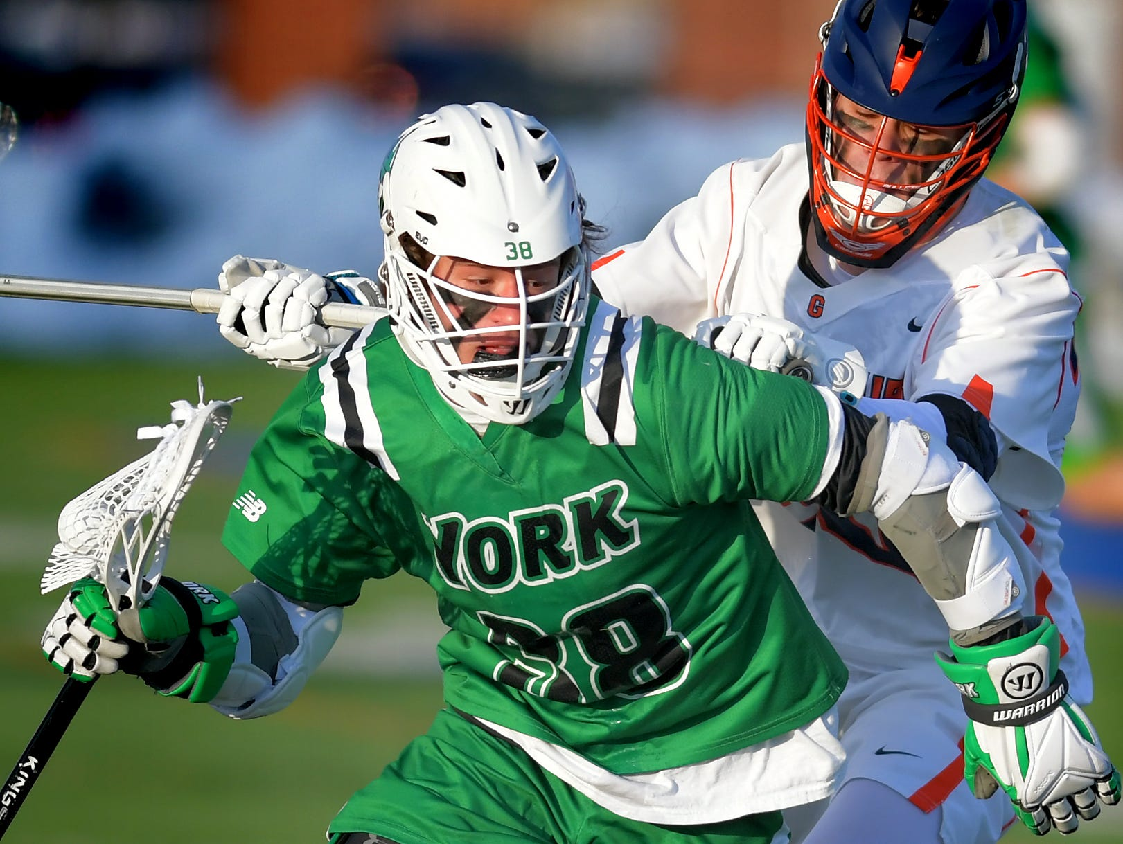 York College's Brendan McGrath moves the ball with Gettysburg College's Andrew Horn defending during lacrosse action at Gettysburg Wednesday, March 6, 2019. Both teams were ranked in the top 10 nationally in NCAA Division III men's lacrosse coming into the game. York won 14-6. Bill Kalina photo