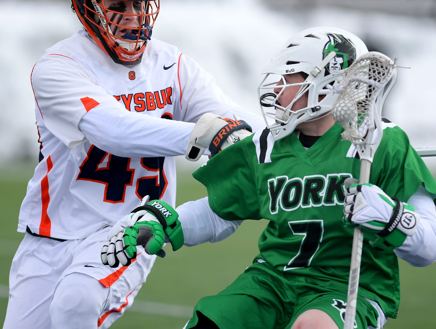 York College's Jake Hvazda tries to shake Gettysburg College's Jackson Mumford during lacrosse action at Gettysburg Wednesday, March 6, 2019. Both teams were ranked in the top 10 nationally in NCAA Division III men's lacrosse coming into the game. York won 14-6. Bill Kalina photo