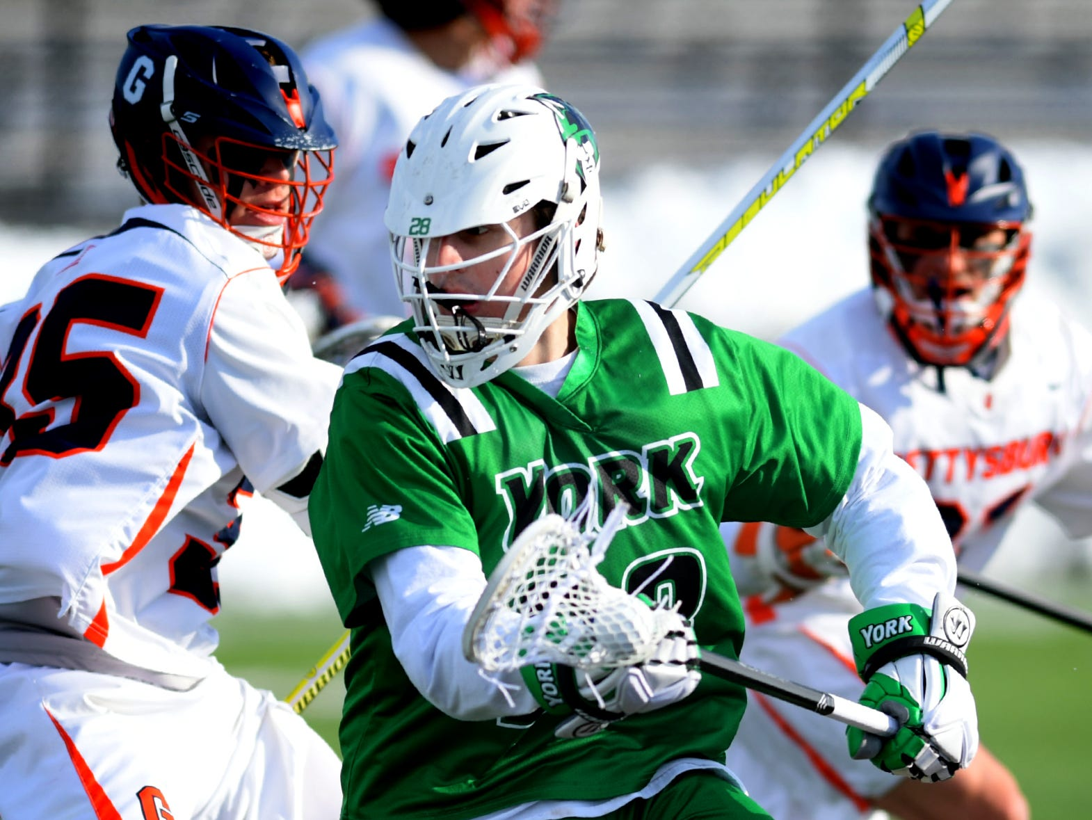 York College's Thomas Pfeiffer changes directions with Gettysburg College defenders pursuing during lacrosse action at Gettysburg Wednesday, March 6, 2019. Both teams were ranked in the top 10 nationally in NCAA Division III men's lacrosse coming into the game. York won 14-6. Bill Kalina photo