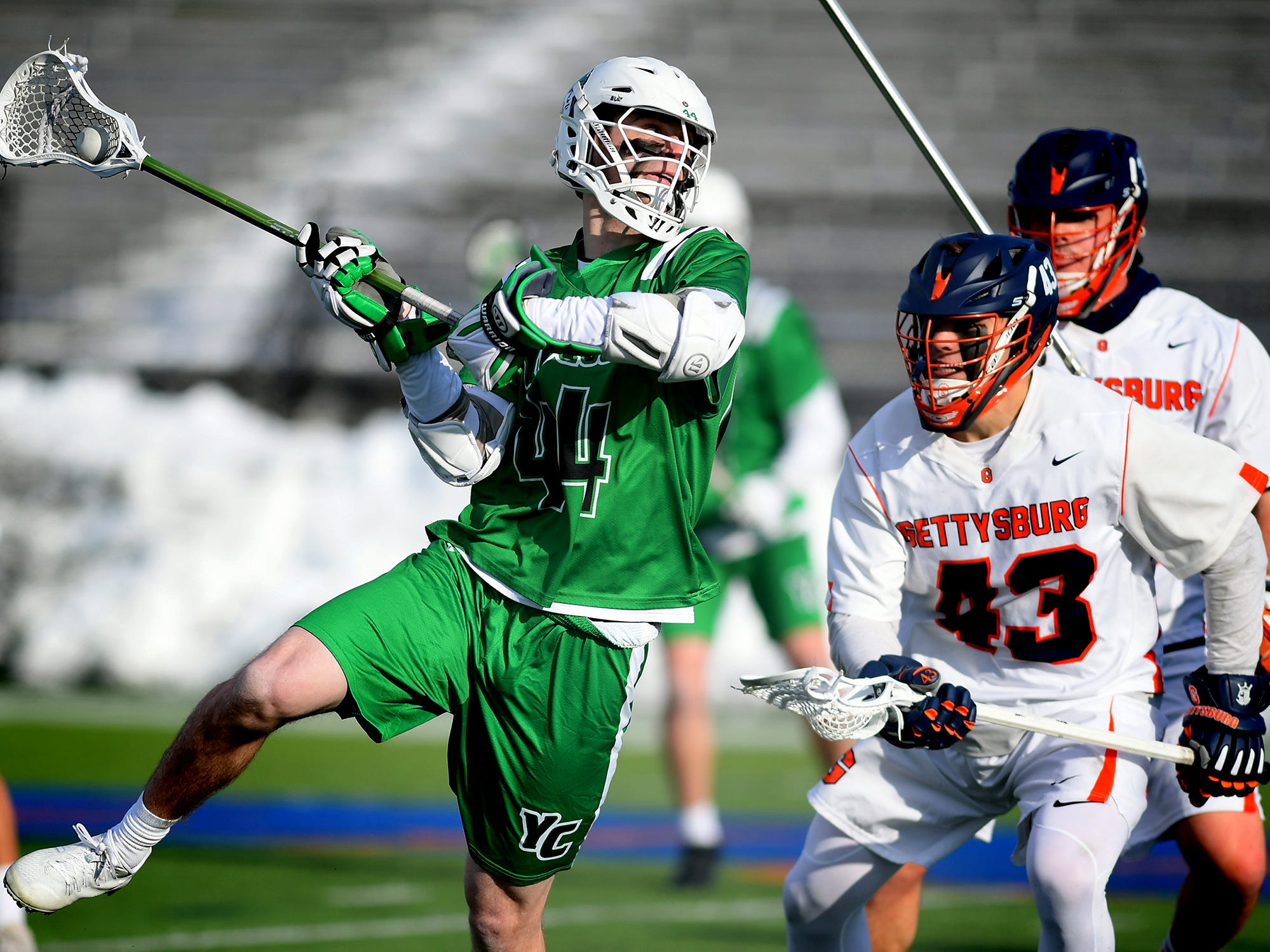 York College's Eric Ranck takes a shot in front of  Gettysburg College's Connor Leach during lacrosse action at Gettysburg Wednesday, March 6, 2019. Both teams were ranked in the top 10 nationally in NCAA Division III men's lacrosse coming into the game. York won 14-6. Bill Kalina photo