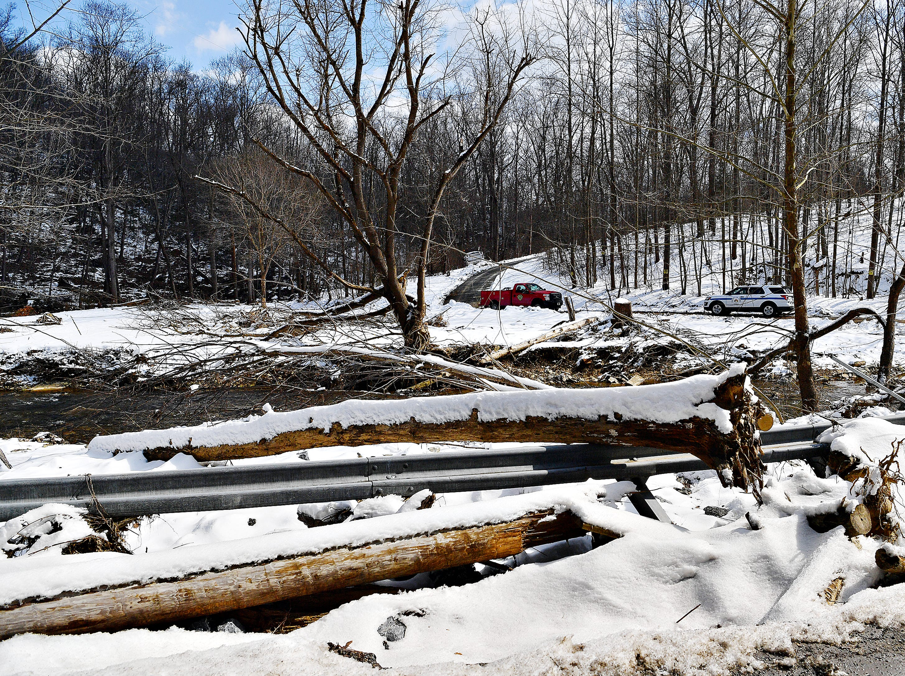 Representatives from the state Department of Environmental Protection discuss flood relief during a press conference at the intersection of Mill and Gum Tree roads in Chanceford Township, Thursday, March 7, 2019. Dawn J. Sagert photo
