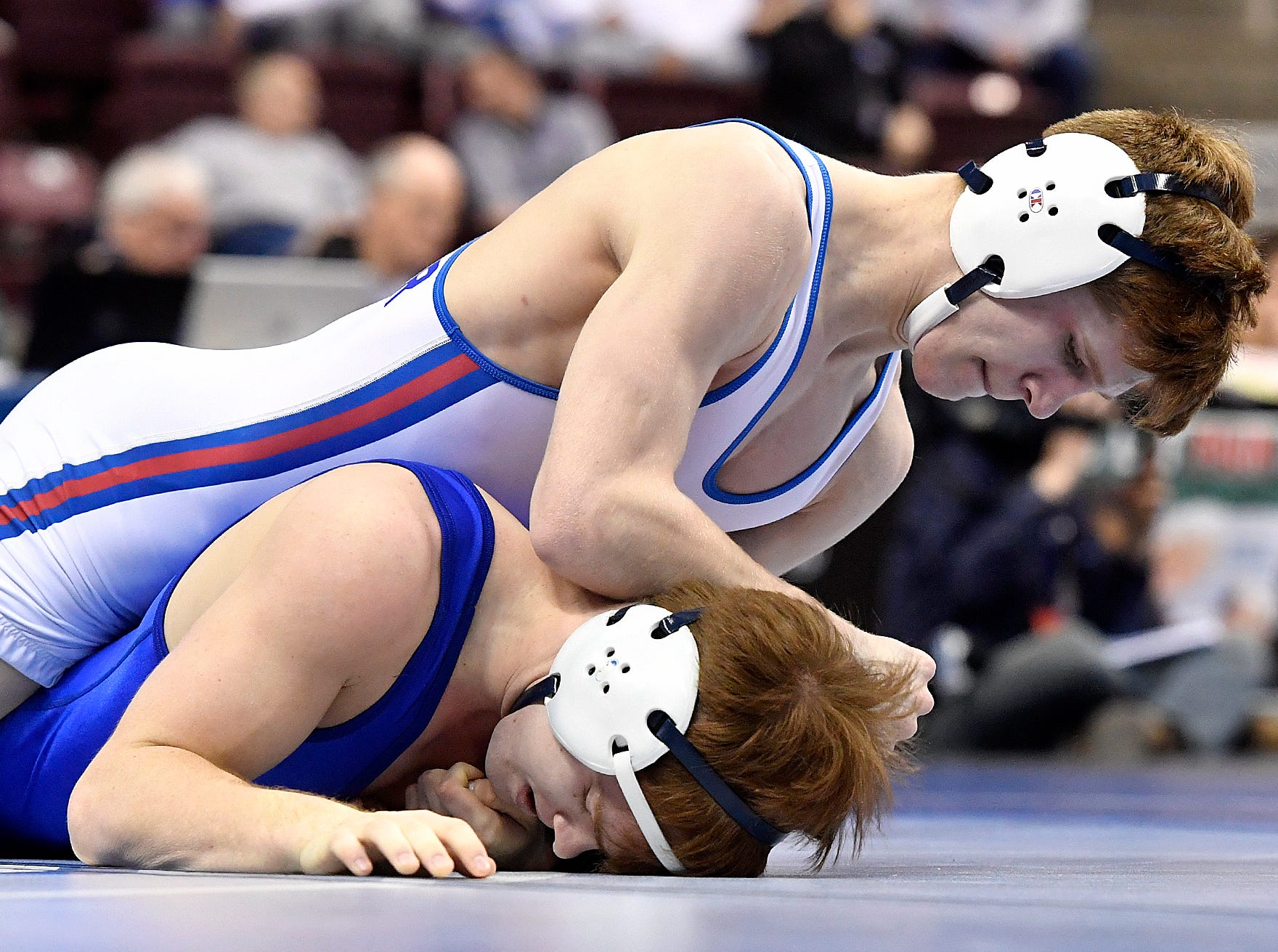 Thomas Dressler of Spring Grove wrestles Colin Franks of Connelsville in the 145 pound preliminary of the PIAA Class 3-A Wrestling Championships, Thursday, March 7, 2019.John A. Pavoncello photo