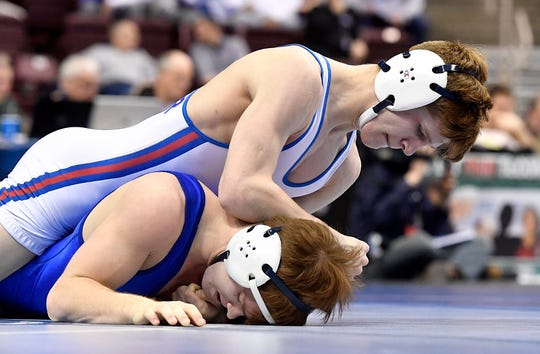 Spring Grove's Thomas Dressler, top, seen here in a file photo, won the individual 170-pound title at the Penn Cambria tournament over the weekend.