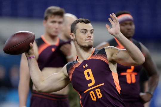 Penn State quarterback Trace McSorley runs a drill at the NFL football scouting combine in Indianapolis, Saturday, March 2, 2019. (AP Photo/Michael Conroy)