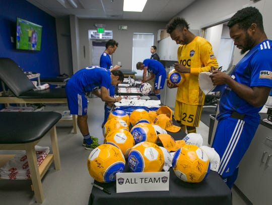 Reno 1868 FC players sign memorabilia at media day at Greater Nevada Field in Reno on Wednesday