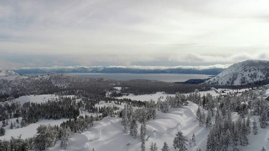 An aerial image of snowy Lake Tahoe shot above a ridgeline near the summit of the Mt. Rose Highway using a drone on March, 4.