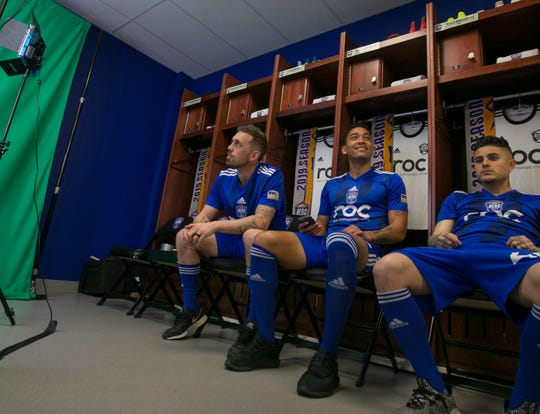 Reno 1868 FC players wait to get their photos taken at media day at Greater Nevada Field on Wednesday.