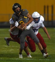 Galena's Alex Laird (9) gets sacked while taking on Reno during their football game at Galena on Aug. 30, 2018.