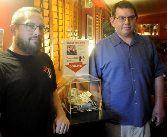 Phil Wooley (left) and David Mickelsen stand next to a donation box Wooley set up for Mickelsen at the Sagebrush Ranch in Mound House.