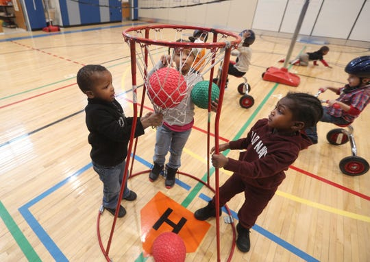 Three-year-old Pre-K students play during a gross motor skills class at School 7.