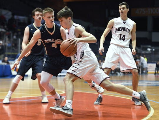 Pittsford Mendon's Michael Harrington, right, drives the baseline against Pittsford Sutherland's Matt Panara during the Class A state qualifier played at The Blue Cross Arena, Wednesday, March 6, 2019. Pittsford Mendon advanced to the state tournament quarterfinal with a 74-53 win over Pittsford Sutherland.