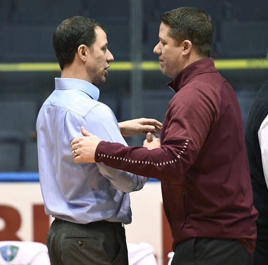 Pittsford Mendon head coach Bob Nally, right, shakes hands with his brother Pittsford Sutherland head coach John Nally following the Class A state qualifier played at The Blue Cross Arena, Wednesday, March 6, 2019. Pittsford Mendon advanced to the state tournament quarterfinal with a 74-53 win over Pittsford Sutherland.
