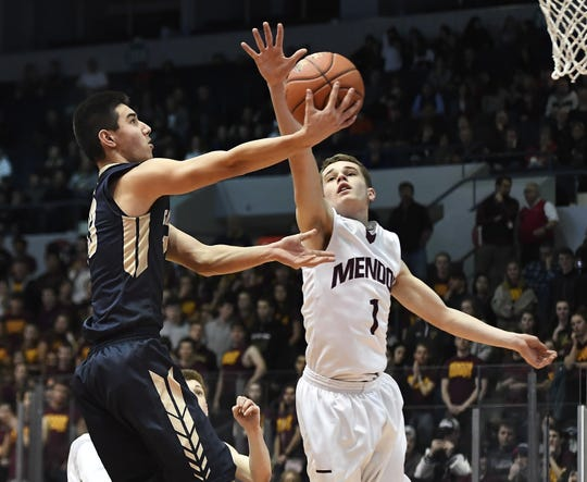 Pittsford Mendon's Jacob Shadders, right, defends against a layup by Pittsford Sutherland's Ben DiGiovanni during the Class A state qualifier played at The Blue Cross Arena, Wednesday, March 6, 2019. Pittsford Mendon advanced to the state tournament quarterfinal with a 74-53 win over Pittsford Sutherland.