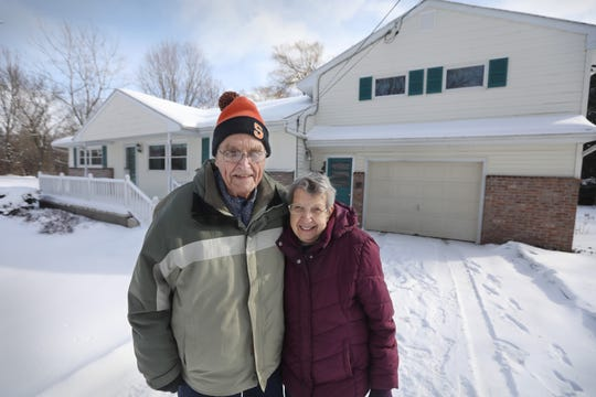 Richard and Marion Campbell stand outside their dream home, that they built on Woodward Road in Webster Wednesday, March 6, 2019.