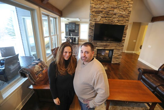 Mary and Mark Leach stand inside their dream home, that they built on County Line Road in Webster Wednesday, March 6, 2019.