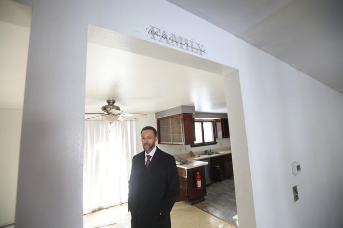 Christopher Thomas, broker and owner, New 2 U Homes, stands in the dining room off the kitchen in a short sale house he has on the market in Greece.