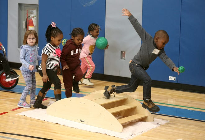 Pre-K students in the three-year-old class at School 7 during a  gross motor skills class.