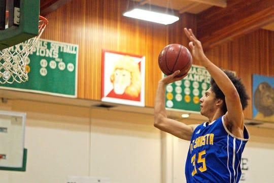 Mt. Shasta senior Kody Baughman shoots during a game against Modoc on Jan. 29.
