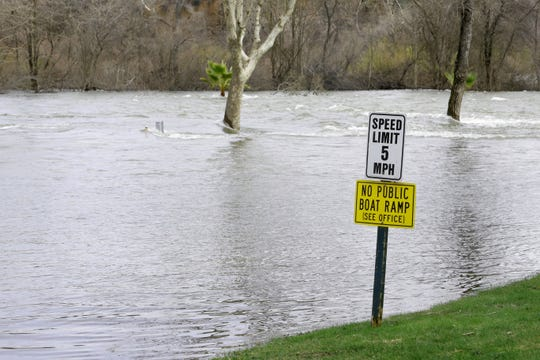 Higher releases from Shasta Dam into the Sacramento River inundates the lower level of the Marina RV Park off Park Marina Boulevard on Saturday, March 2, 2019.