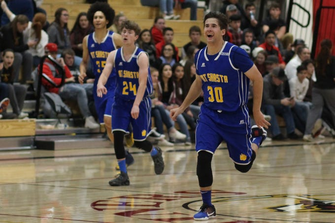 Mt. Shasta players Kaden Riccomini (30), Nolan Johnson (24) and Kody Bauman (35) run down the court during the opening week of the 2018-19 season at the Yreka Invitational.
