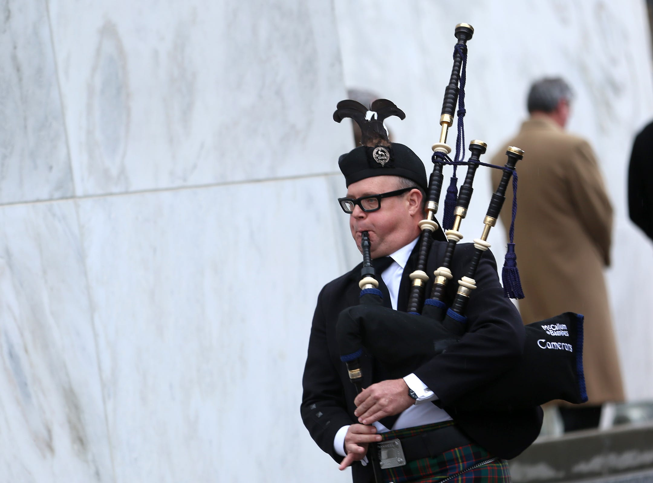 John Goff, on bag pipes, peforms after the state funeral for Secretary of State Dennis Richardson at the Oregon State Capitol in Salem on Wednesday, March 6, 2019.