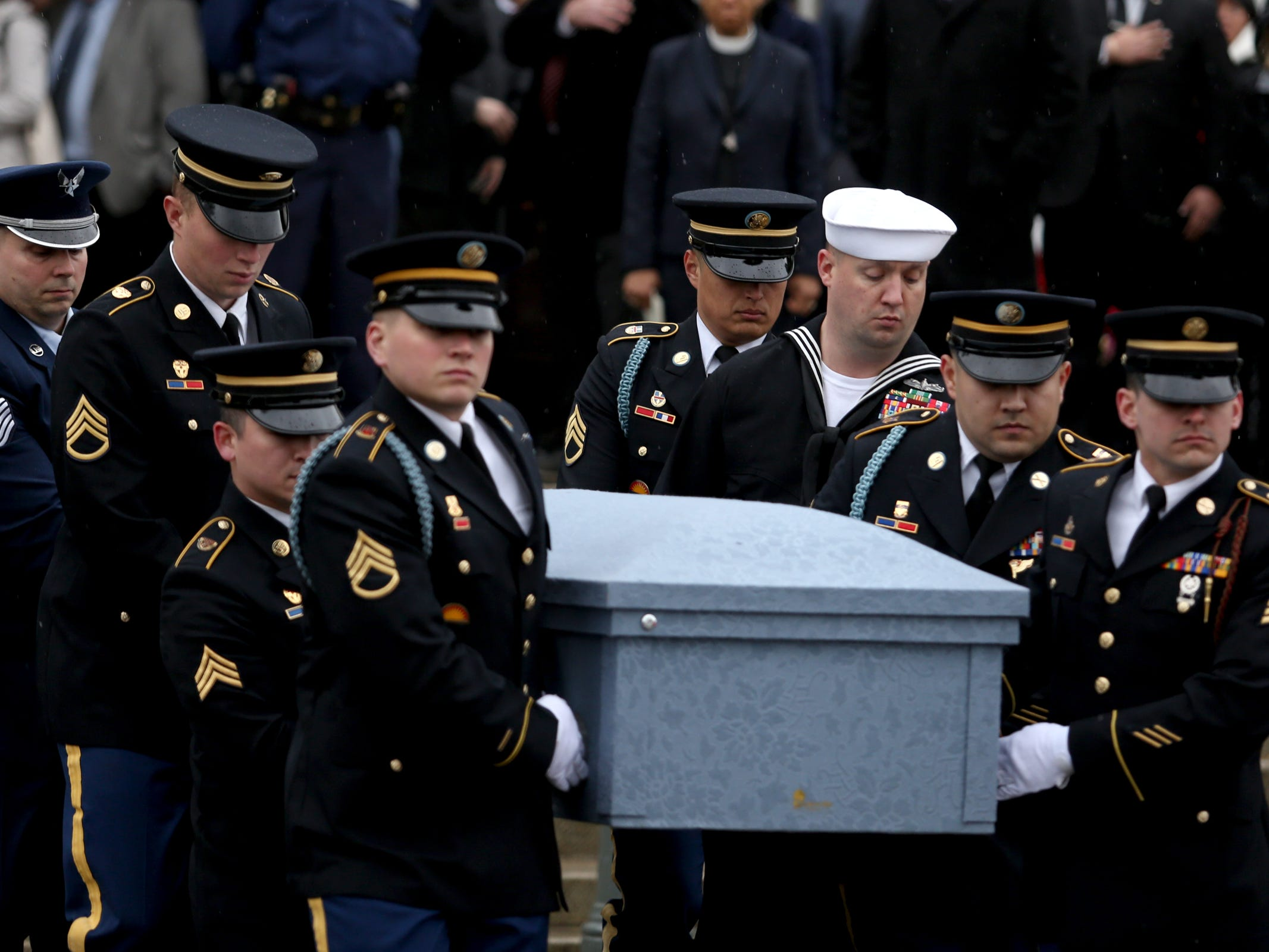 The casket is carried during the state funeral for Secretary of State Dennis Richardson at the Oregon State Capitol in Salem on Wednesday, March 6, 2019.