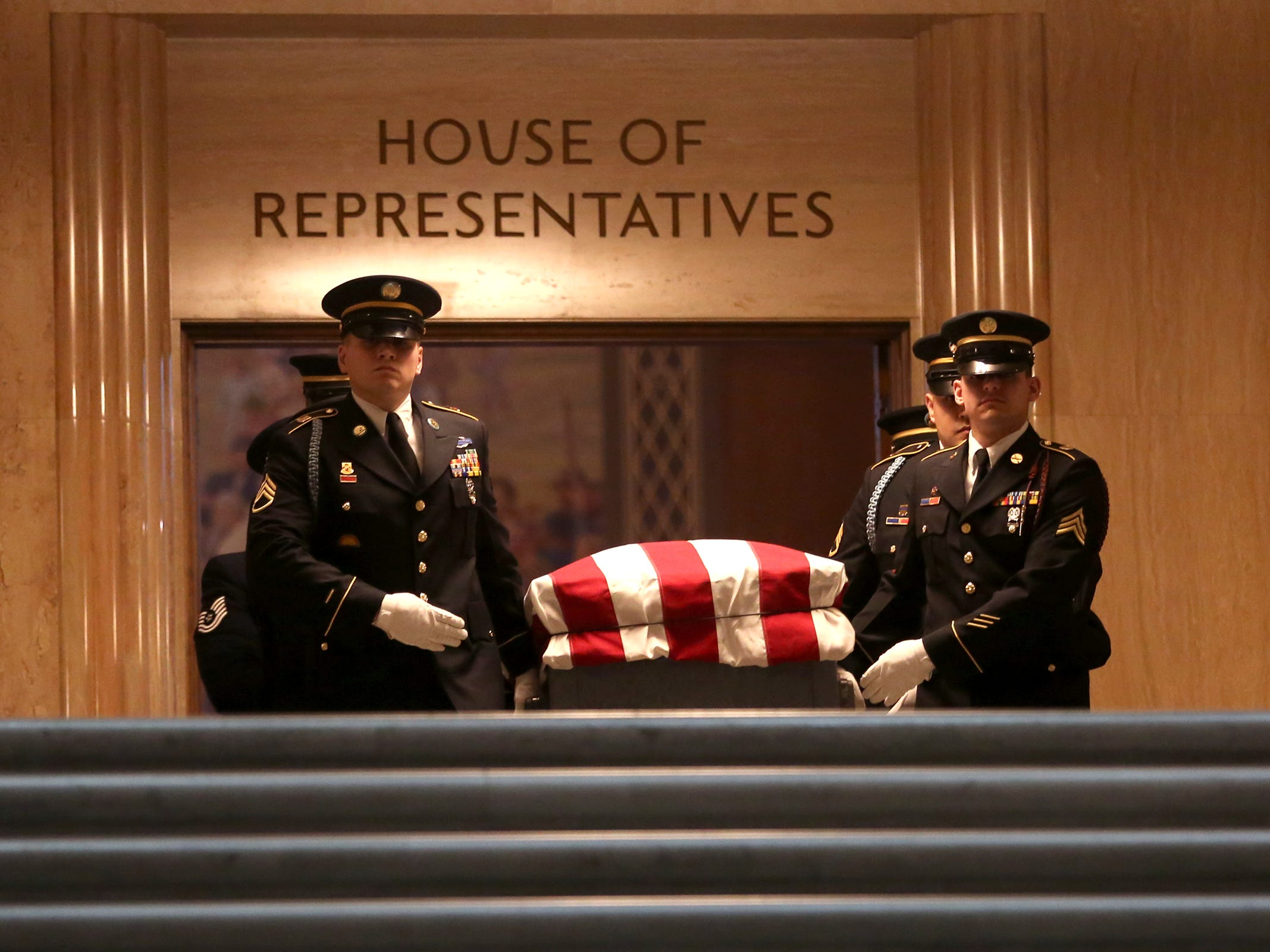 The casket is escorted out of the House of Representatives after the state funeral for Secretary of State Dennis Richardson at the Oregon State Capitol in Salem on Wednesday, March 6, 2019.