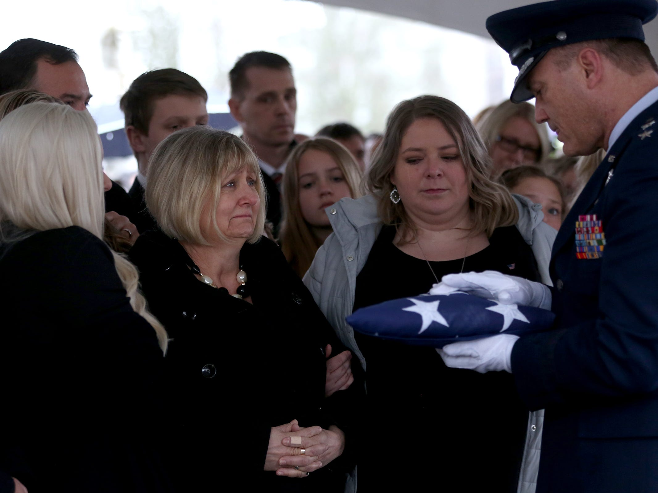 Cathy Richardson is presented with the flag following the state funeral for Secretary of State Dennis Richardson at the Oregon State Capitol in Salem on Wednesday, March 6, 2019.