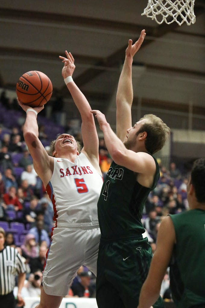 South Salem's Ryan Brown (5) takes a shot after winning a rebound from Tigard's Stevie Schlabach (4) during the OSAA 6A boys basketball state tournament quarterfinal on Wednesday, March 6 at Chiles Center.