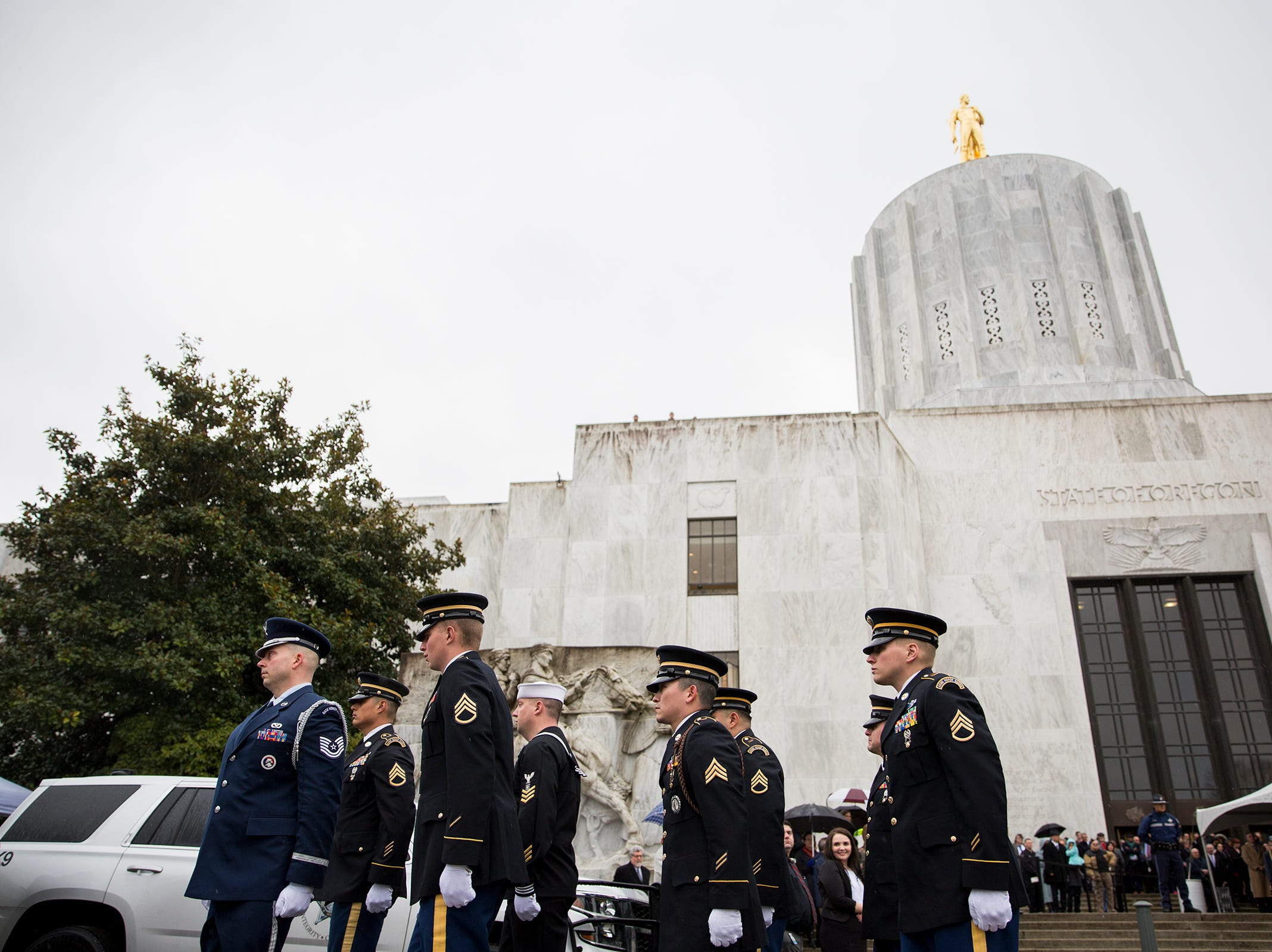 Military members finish placing the casket in the hearse following the state funeral for Secretary of State Dennis Richardson at the Oregon State Capitol in Salem on Wednesday, March 6, 2019.