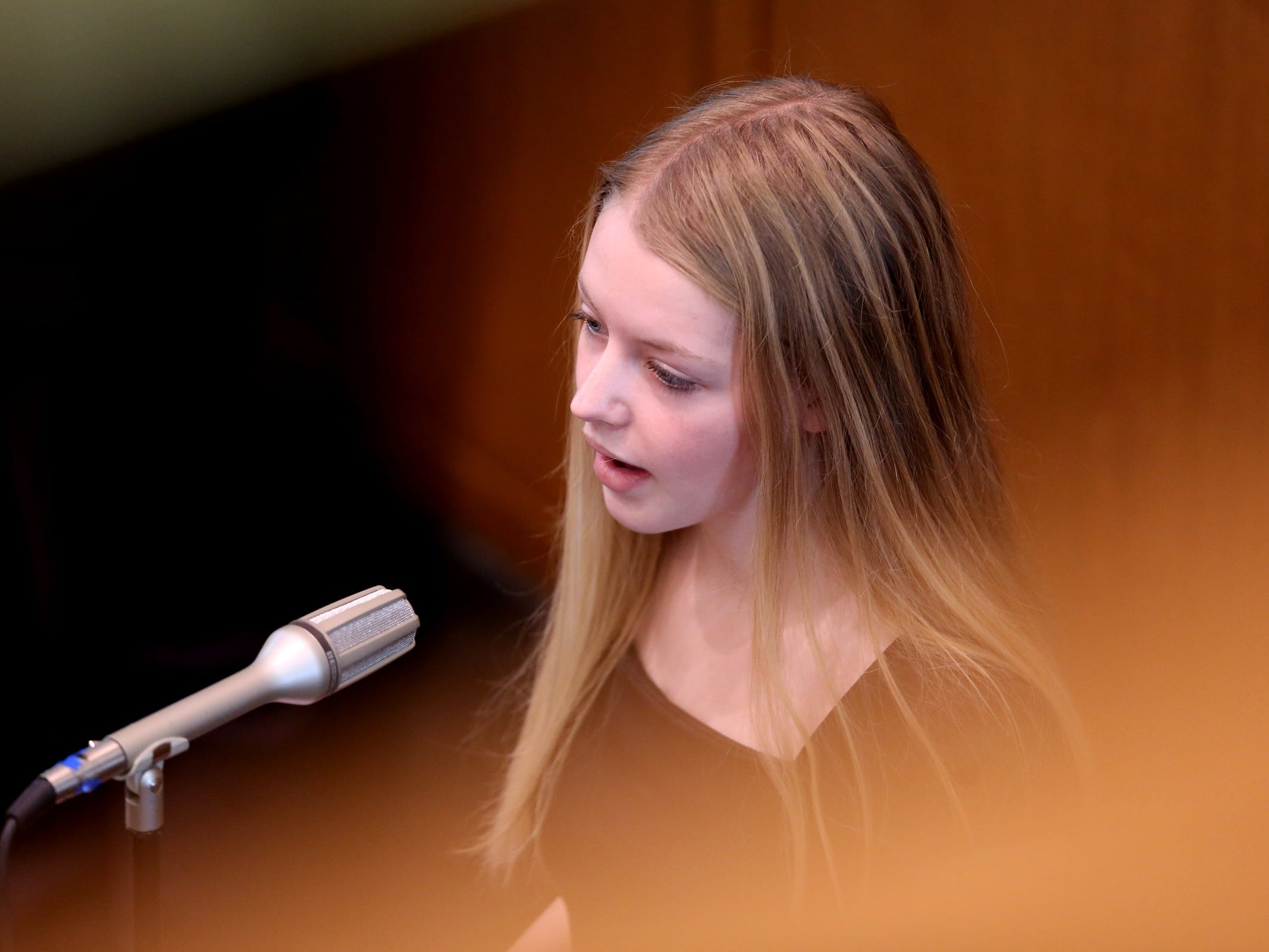 Asia Whoolery, sings during the state funeral for her grandfather, Secretary of State Dennis Richardson, at the Oregon State Capitol in Salem on Wednesday, March 6, 2019.