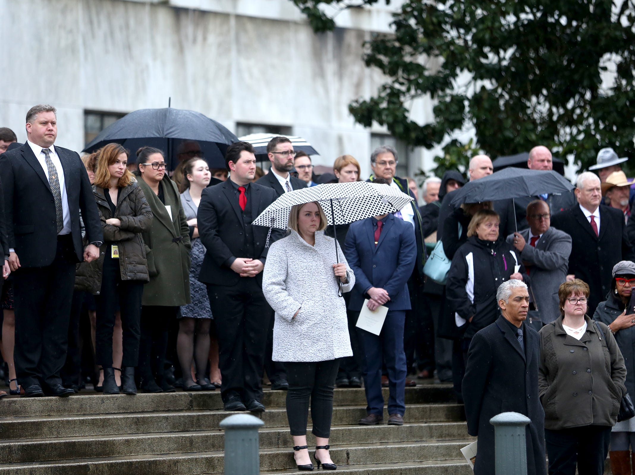 Spectators watch as the casket of Secretary of State Dennis Richardson leaves at the Oregon State Capitol in Salem on Wednesday, March 6, 2019.