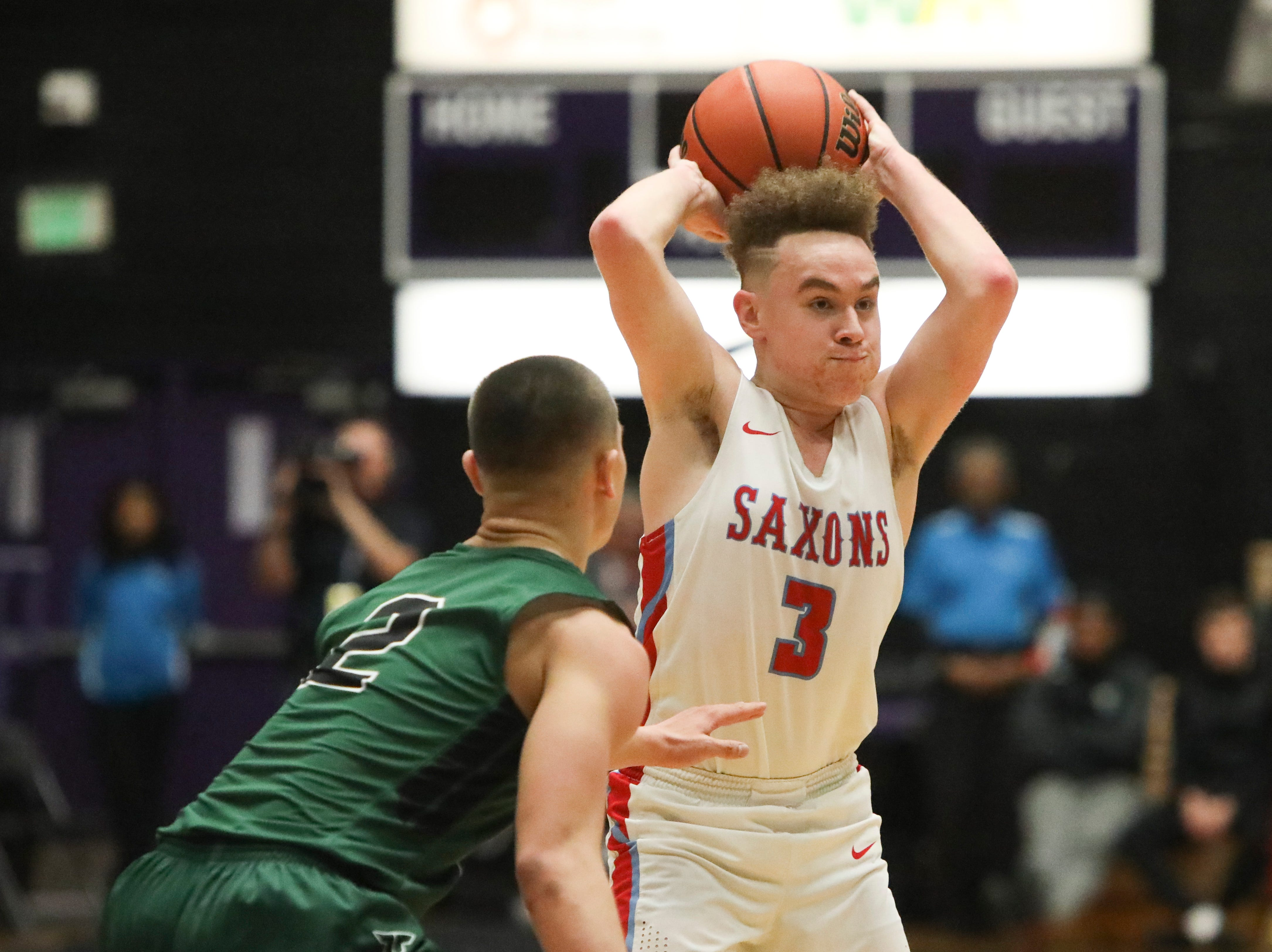 South Salem's Trey Galbraith (3) passes to a teammate during the OSAA 6A boys basketball state tournament quarterfinal against Tigard  on Wednesday, March 6 at Chiles Center.