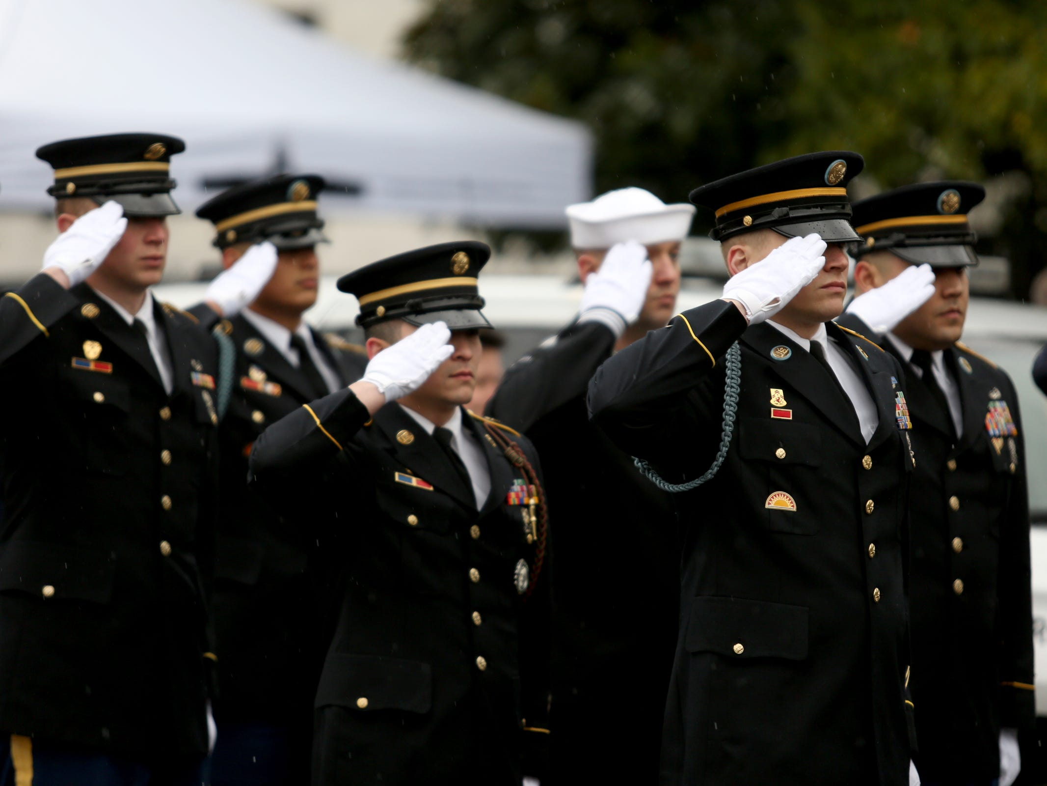 Military members salute during the state funeral for Secretary of State Dennis Richardson at the Oregon State Capitol in Salem on Wednesday, March 6, 2019.