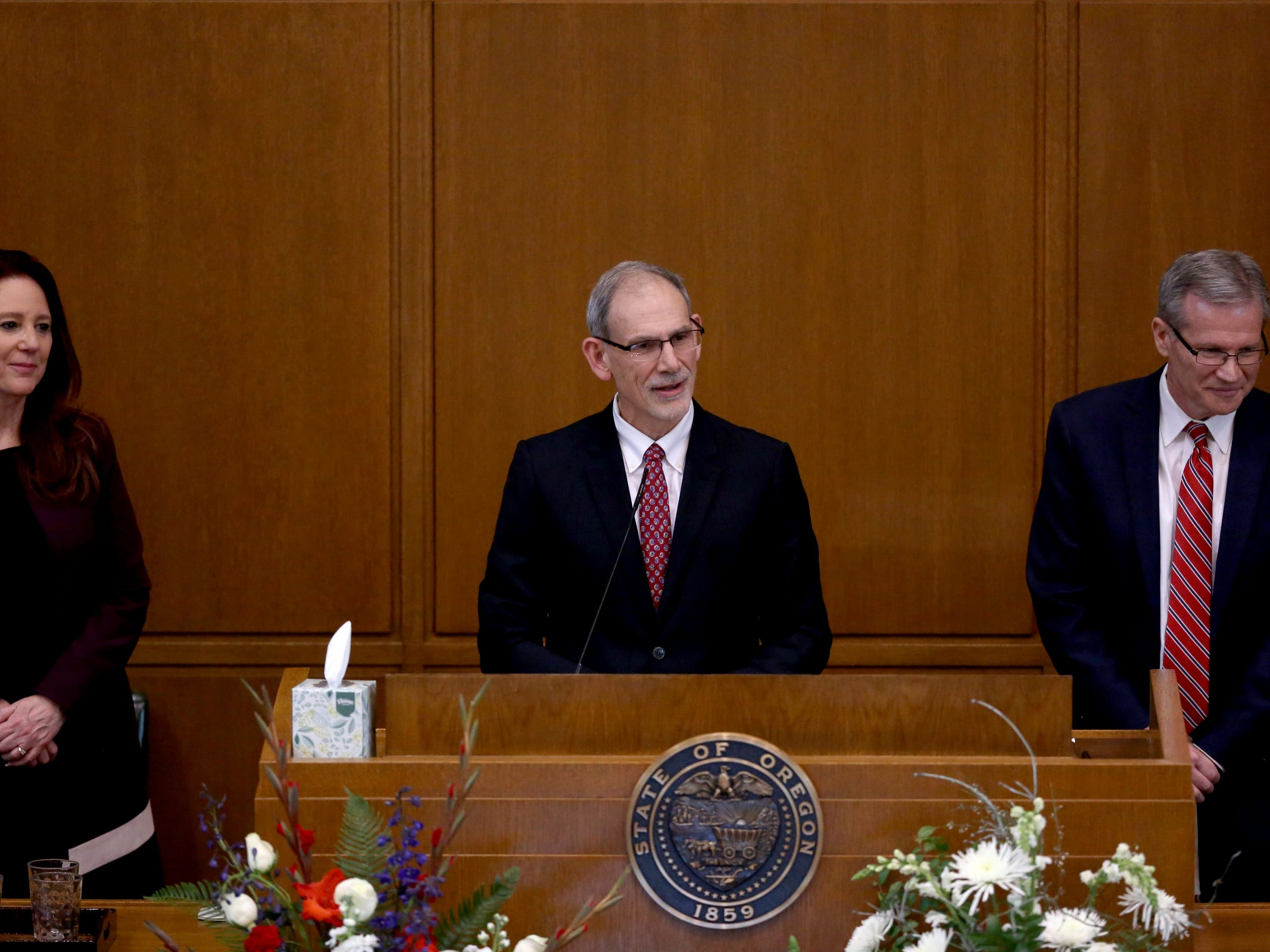 Former Secretary of State Phil Keisling, center, speaks during the state funeral for Secretary of State Dennis Richardson at the Oregon State Capitol in Salem on Wednesday, March 6, 2019.