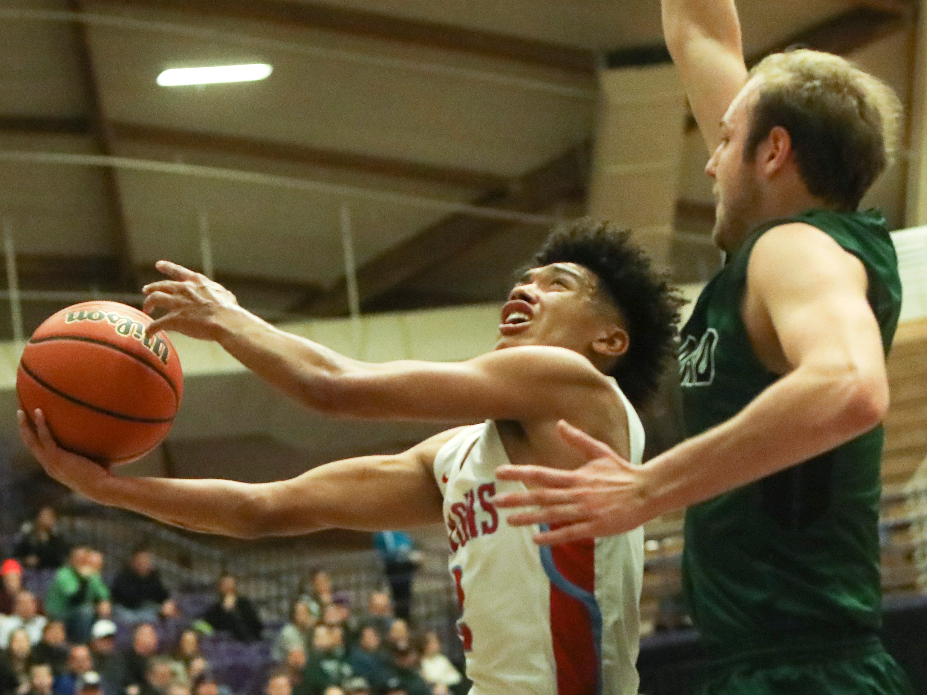 during the OSAA 6A boys basketball state tournament quarterfinal on Wednesday, March 6 at Chiles Center.