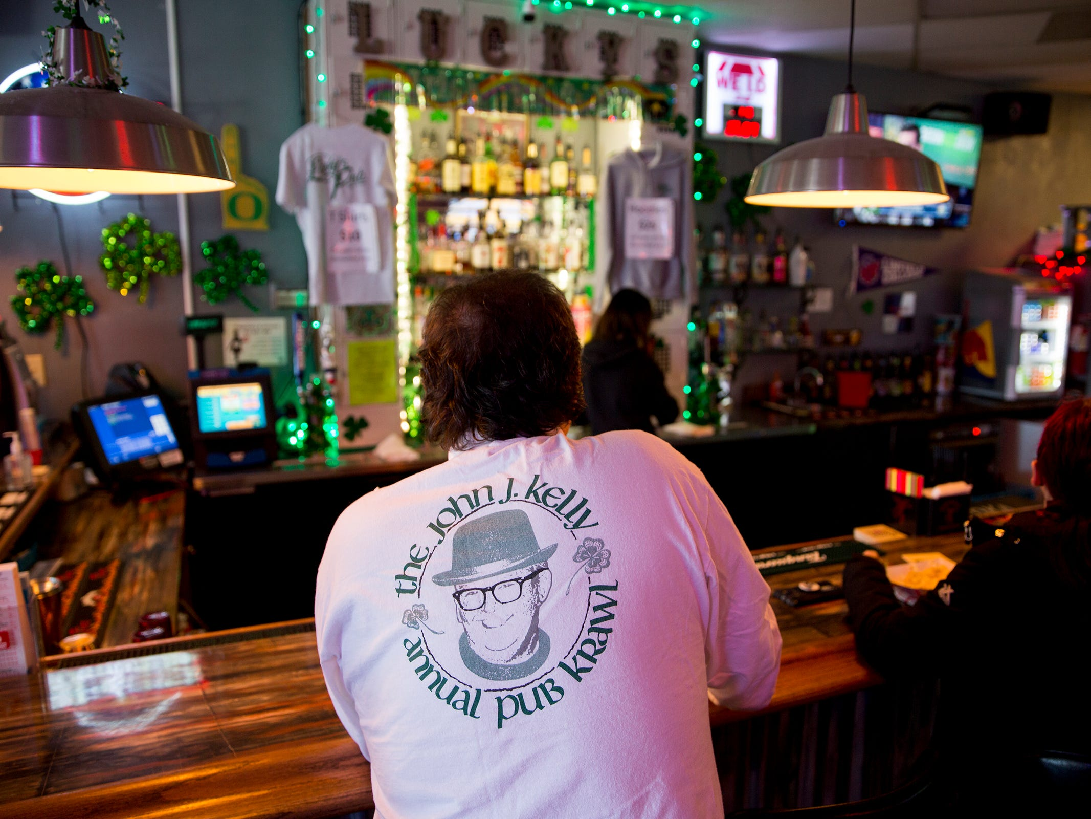 Terry Kelly wears a John J. Kelly Pub Krawl shirt, at his daughter Hannah Kelly's bar Lucky's Pub in Salem on Thursday, Mach 7, 2019.