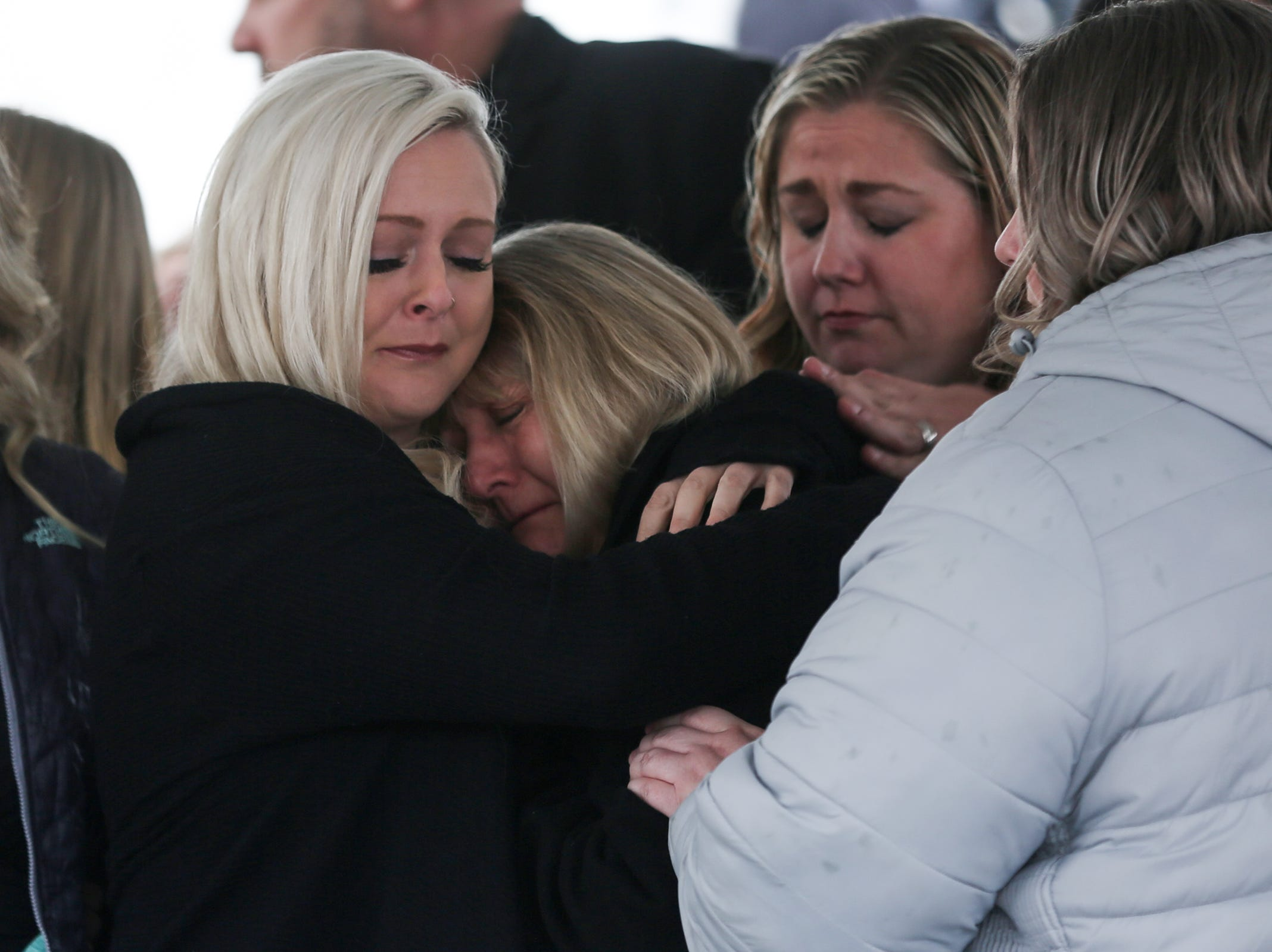 Cathy Richardson and her daughters embrace one another following the state funeral for Secretary of State Dennis Richardson at the Oregon State Capitol in Salem on Wednesday, March 6, 2019.