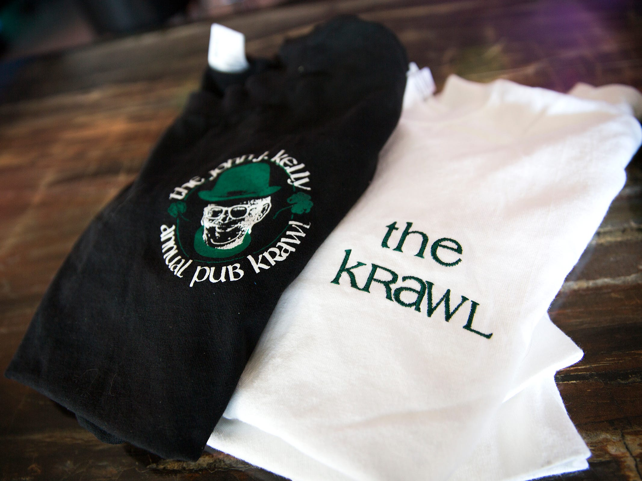 A shirt from an older John J. Kelly Pub Krawl and a newer one are pictured at Lucky's Pub in Salem on Thursday, Mach 7, 2019.