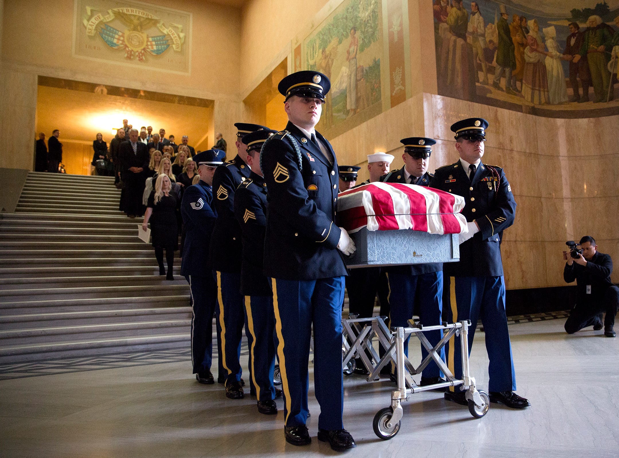 The casket is escorted to the front steps of the Capitol following the state funeral for Secretary of State Dennis Richardson at the Oregon State Capitol in Salem on Wednesday, March 6, 2019.