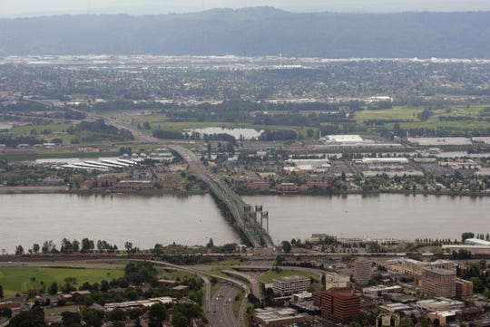 Interstate 5 crosses the Columbia River and Hayden Island as it heads from Vancouver, Wash., bottom, toward Portland, Ore.