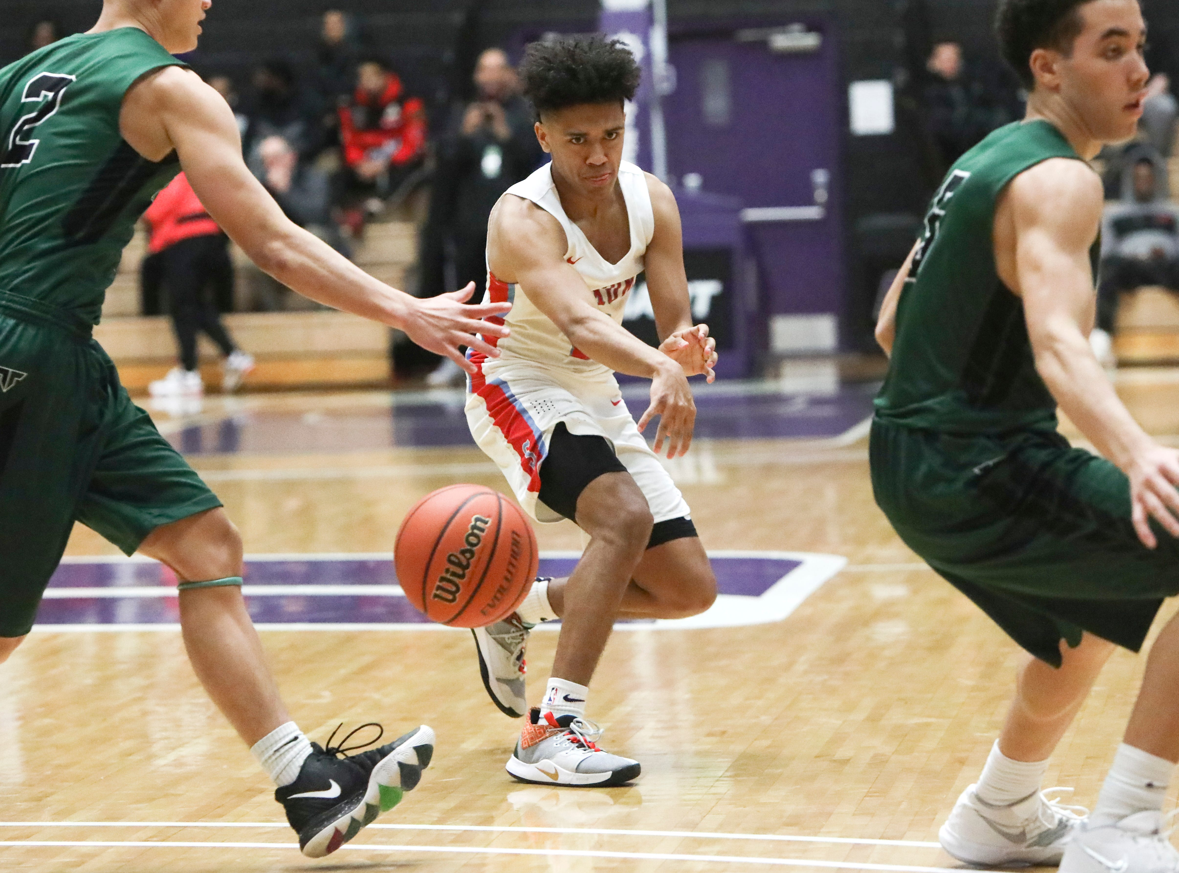 South Salem's Jaden Nielsen-Skinner (2) passes to a teammate during the OSAA 6A boys basketball state tournament quarterfinal against Tigard on Wednesday, March 6 at Chiles Center.
