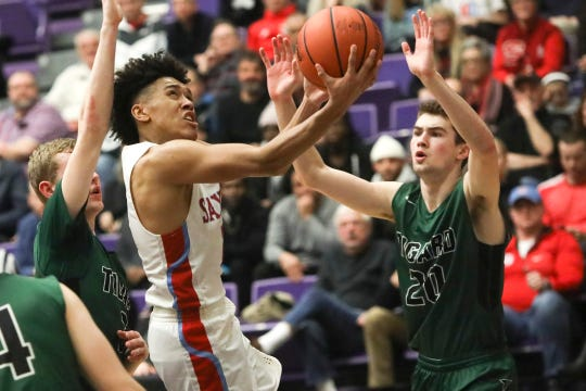 South Salem's Jaden Nielsen-Skinner (2) drives to the basket during the OSAA 6A boys basketball state tournament quarterfinal on Wednesday, March 6 at Chiles Center.