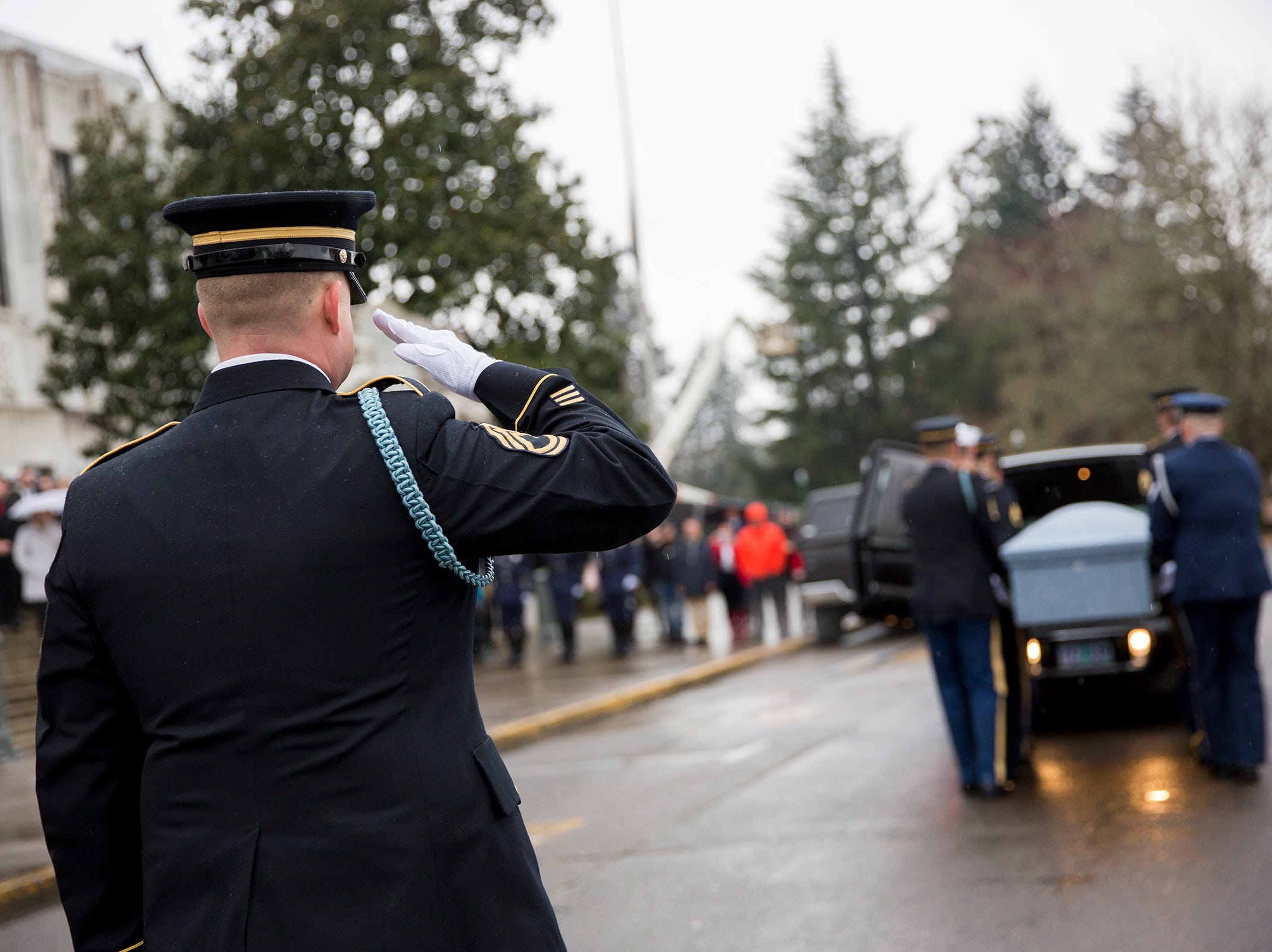 The casket is saluted as it is placed in the back of the hearse following the state funeral for Secretary of State Dennis Richardson at the Oregon State Capitol in Salem on Wednesday, March 6, 2019.