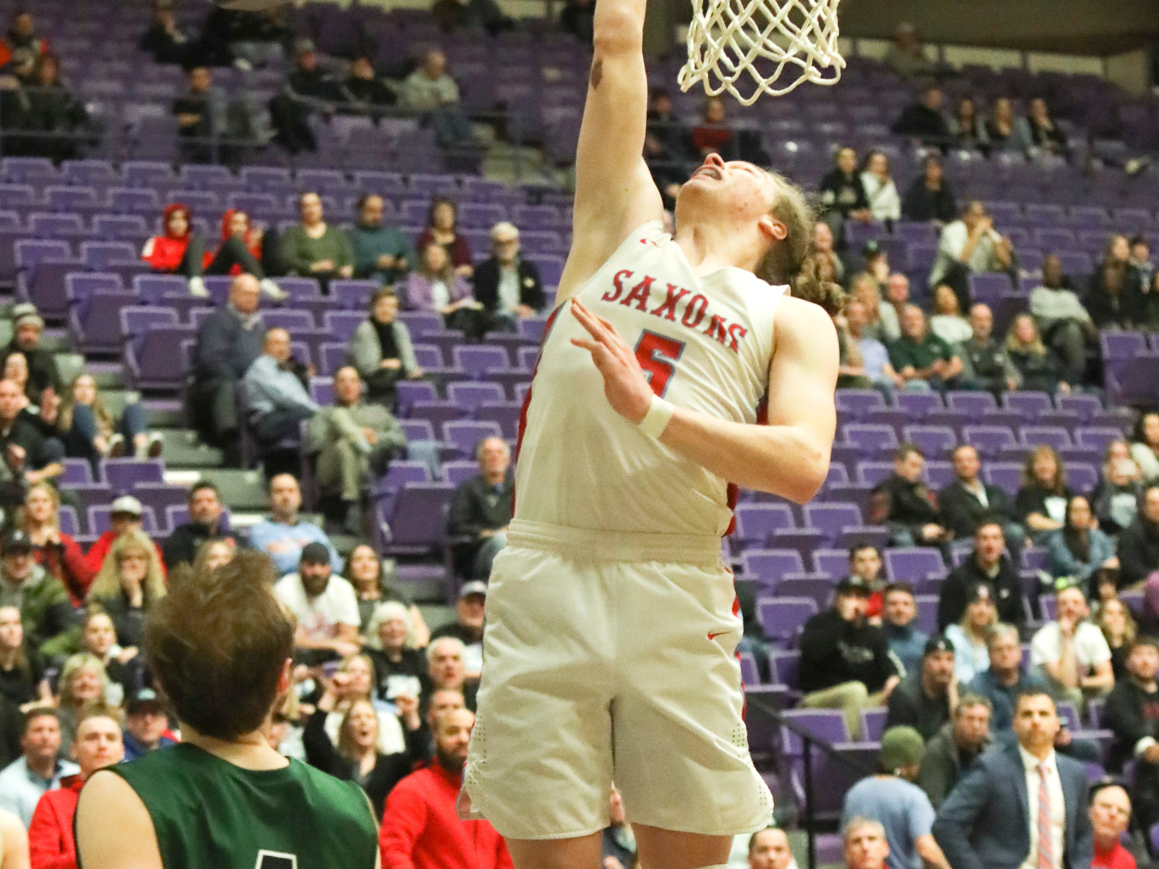 South Salem's Ryan Brown (5) makes a layup against Tigard during the OSAA 6A boys basketball state tournament quarterfinal on Wednesday, March 6 at Chiles Center.
