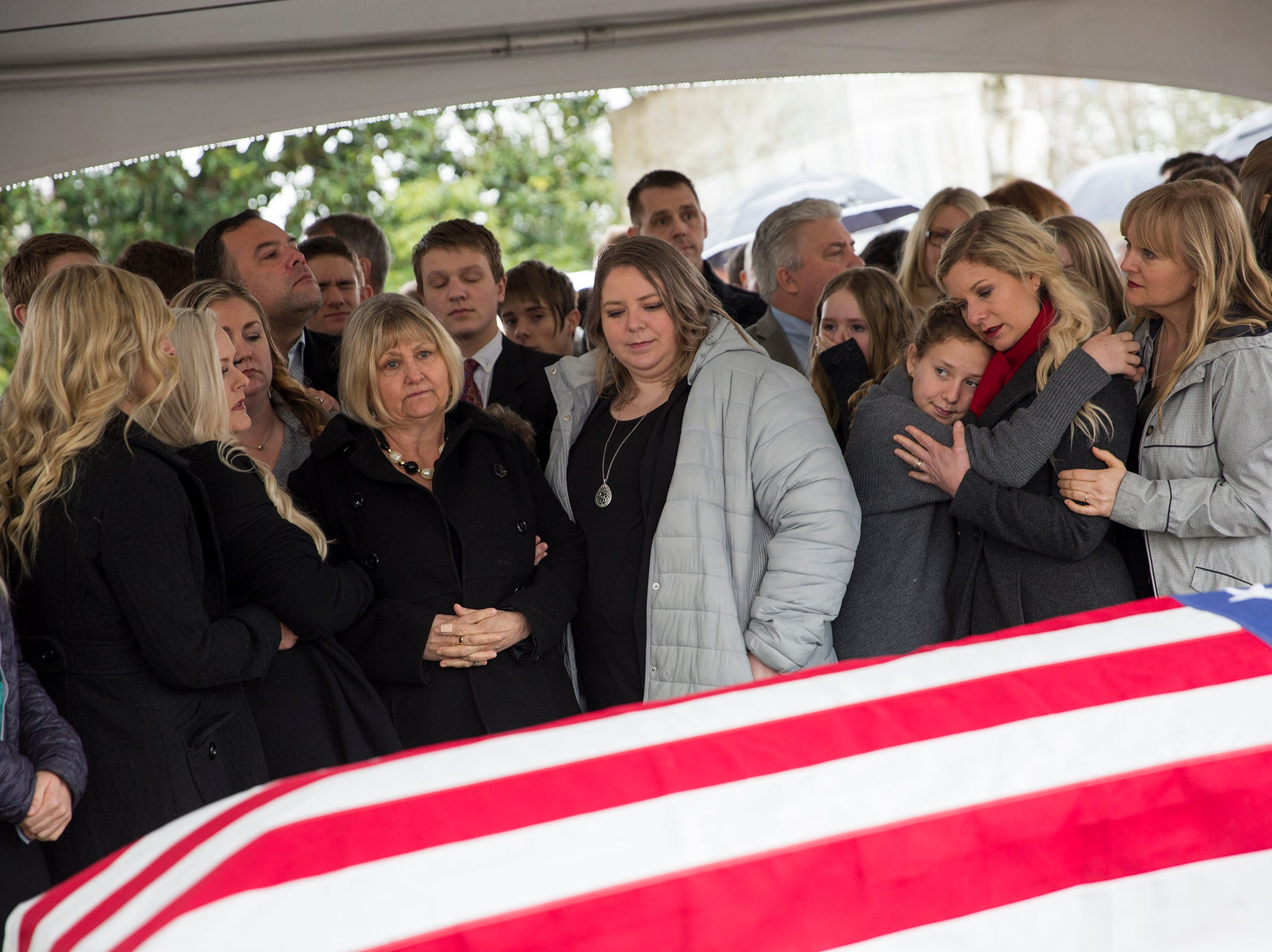 Cathy Richardson and her daughters wait for the ceremonial flag folding following the state funeral for Secretary of State Dennis Richardson at the Oregon State Capitol in Salem on Wednesday, March 6, 2019.