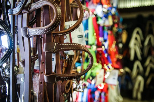 Tack is displayed for sale at Palmer Feed.