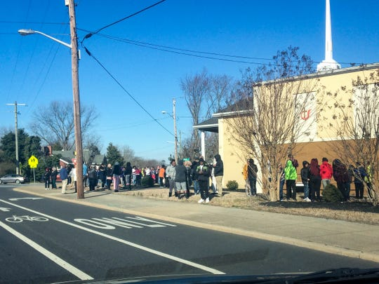A crowd waits outside the Parkway Church of God across from Wicomico Middle School on Thursday morning, March 7, 2019.